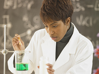 African female science teacher conducting experiment