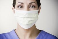 Hispanic female doctor wearing surgical mask