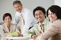 Portrait of businesspeople at conference table