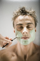 Man receiving spa facial treatment