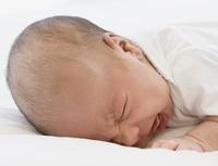 Close up of newborn baby crying