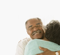 Senior African couple hugging