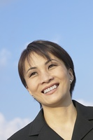 Close up of Asian businesswoman smiling