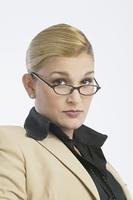 Hispanic businesswoman wearing eyeglasses