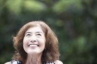 Senior Asian woman laughing