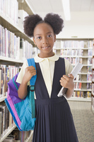 African American girl holding backpack