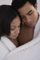 African couple wrapped in blanket