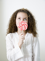 Mixed race girl with oversized lollipop