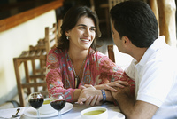 Couple drinking red wine in cafe