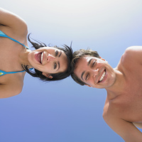 Low angle view of couple smiling