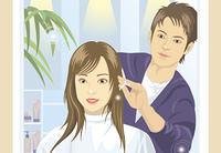 美容院で髪を切っている女性