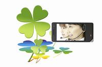携帯画面に写るオペレーターとよつ葉のクローバー