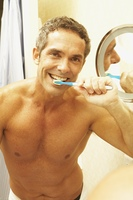 Portrait of middle-aged man brushing teeth