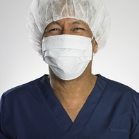 Portrait of Indian male doctor wearing surgical mask