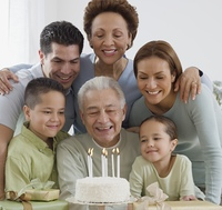 Senior Hispanic man celebrating birthday with family