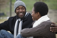 African couple smiling at each other