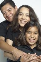 Hispanic family hugging