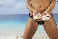 South American woman holding seashells