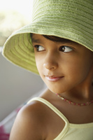 Hispanic girl wearing hat