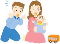 赤ちゃんと遊ぶ夫婦