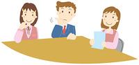 会議中のビジネスマンとビジネスウーマン