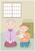 祖母に花束を渡す少年