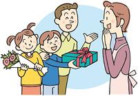贈り物を渡す親子