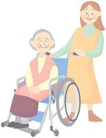 笑顔の高齢者と介護者