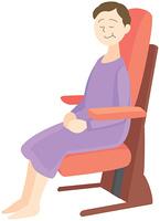 椅子に座る高齢の女性