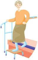 段差を下りる高齢の女性