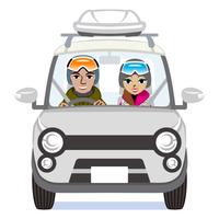 シルバーの車 スキーウェアを着たカップル ルーフキャリア付き