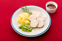Garnish of herbs flavor chicken breast meat and vegetables