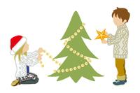 クリスマスツリーの飾り付けをする二人の子供