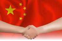 中国  国旗 手 握手