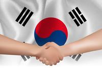 韓国  国旗 手 握手