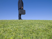 African businessman holding briefcase