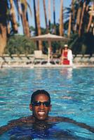 African man swimming in swimming pool