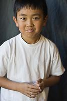 Asian boy making a face