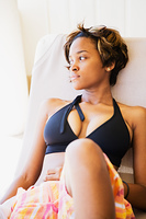 African woman laying on lounge chair