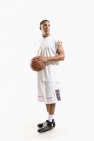 Mixed race basketball player holding ball