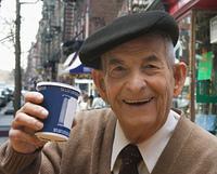 Senior Hispanic man drinking coffee