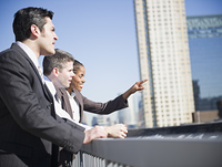 Business people looking at city buildings