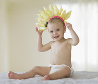 Caucasian baby girl with flower headband