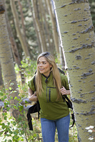 Hispanic woman hiking in forest