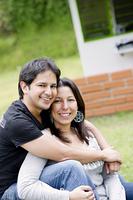 Hispanic couple sitting together