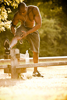 African American man stretching before exercise