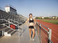 Caucasian runner standing near track