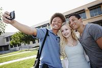 School friends taking self-portrait