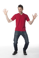 Caucasian man with arms raised