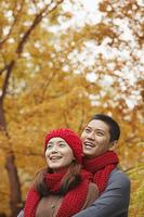 Chinese couple enjoying autumn leaves
